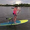 Woman with her dog on a paddleboard