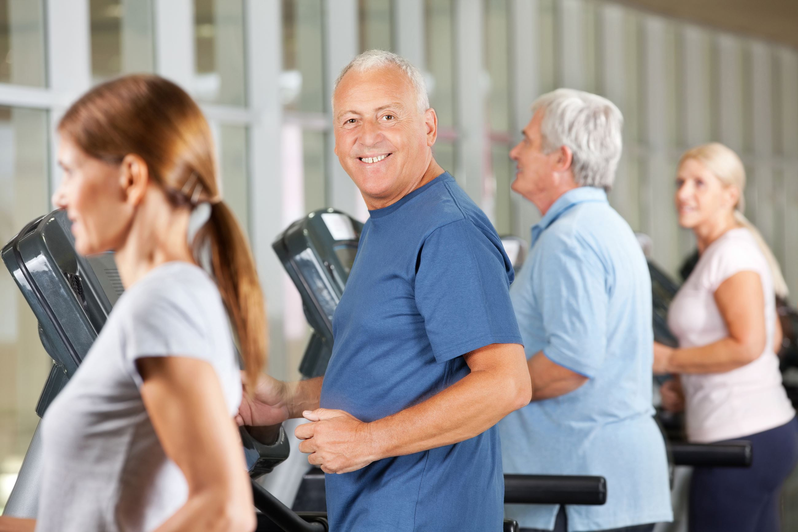 happy folks on treadmills