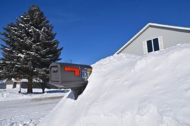 mailbox buried in snow