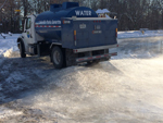 water truck floods a skating rink